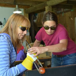Woman Blowing Glass with Teacher